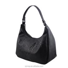 genuine lady leather butterfly rivet shape handbag for day use / lady handmade bowling handbag