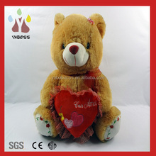 soft plush bear toy with red heart