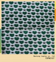 the green heart and black spider printed cotton voile shirt fabric