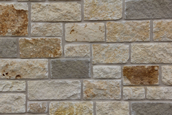 low cost compound wall and housing construction stone