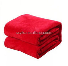 making all kinds of fluffy coral fleece throw blankets plain red