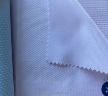 Dobby Solid Shirting light pink Fabric in poly cotton blend woven textile