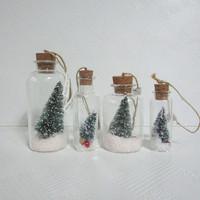 Clear glass bottle decoration w/ mini green sisal tree & artificial snow inside