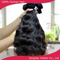 Qingdao proveedor virgen del pelo humano, virgen extensiones de cabello humano brasileño onda natural de color negro precio venta al por mayor