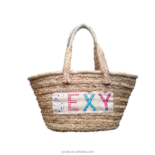 Popular style in Spain,OEM letters beach natural straw bag