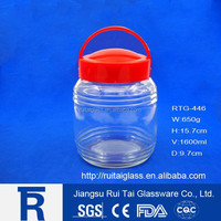 1600ml clear glass storage candy jar with red plastic cap with handle