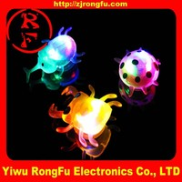 Wholesale plastic led toy/small led animal /glow spin toy