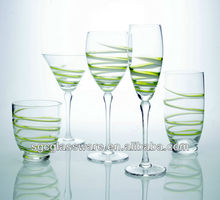 clear wine glass with green swirl