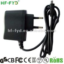 12v 300ma ac power adapter with a positive in the conductor center