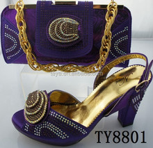 purple ladies shoes and matching bags lower wedge