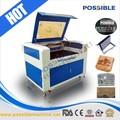 posible de la fábrica directamente la venta co2 láser máquina de corte para paneles de operador