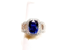 LONG CUSHION CUT SAPPHIRE SET WITH ROUND DIAMONDS DESIGN GOING DOWN SIDES RING