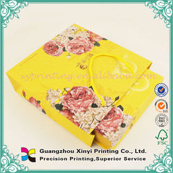 Cotton rope handle hot-sale cheap yellow paper bags for seed