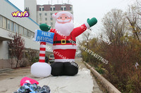 Giant christma inflatable Santa with North Pole sign for sale