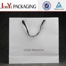 Matt white carrying custom white garment paper bags Canada