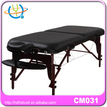 black massage table with wooden frame and legs