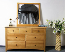solid oak wood 3 over 4 storage chest of drawers used as solid oak wood bedroom furniture