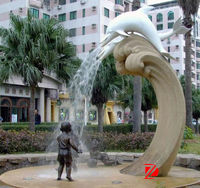 dolphin fountain with statue