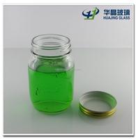 Hot sale 600ml 20oz clear empty round bulk embossed glass jam jar honey mason jar with vaccum tinplate screw cap wholesale