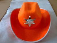 Orange felt cowboy hat with silver metal badge