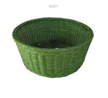 green rattan bowl holding fruit