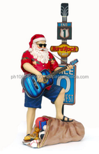 Traveling Santa Claus with Guitar. ID: DZ