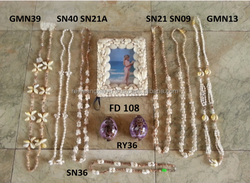 Cowrie Shell Necklaces and Shell Picture Frames