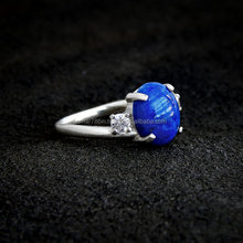 falak gems Lapis and Sterling Ring - white CZ accent, sterling silver swirl, twist, lapis lazuli rings