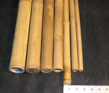 Straight raw bamboo poles made from natural bamboo materials