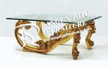 Carved gold coffee table With Glass Top