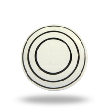 ceramic white knob w/ black circles
