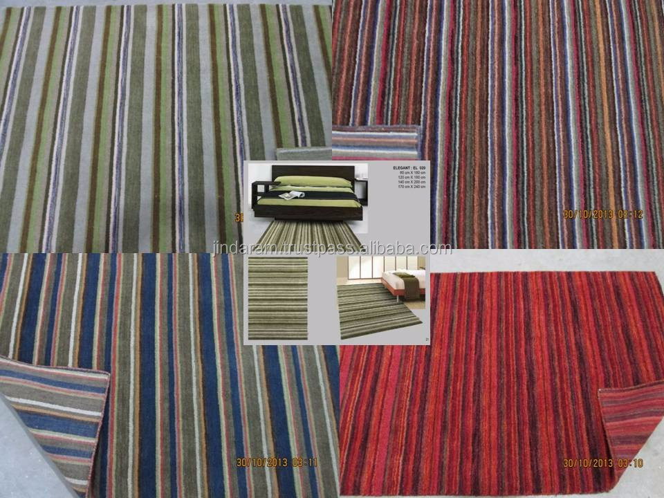 Traditional cotton woven carpets for household uses.JPG