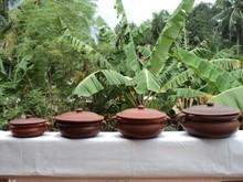 arcilla terracota curry bowl con el mango
