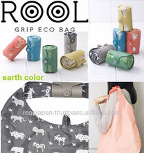 Designer shopping bags with an Elastomer Grip and Magnet for storage