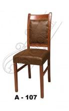 sculpted high back wood chair