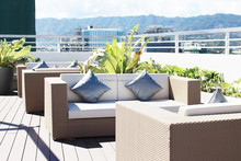 Loveseat synthetic rattan sofa with pillows