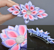 Handmade designer hair clip with kanzashi flower in tender color palette
